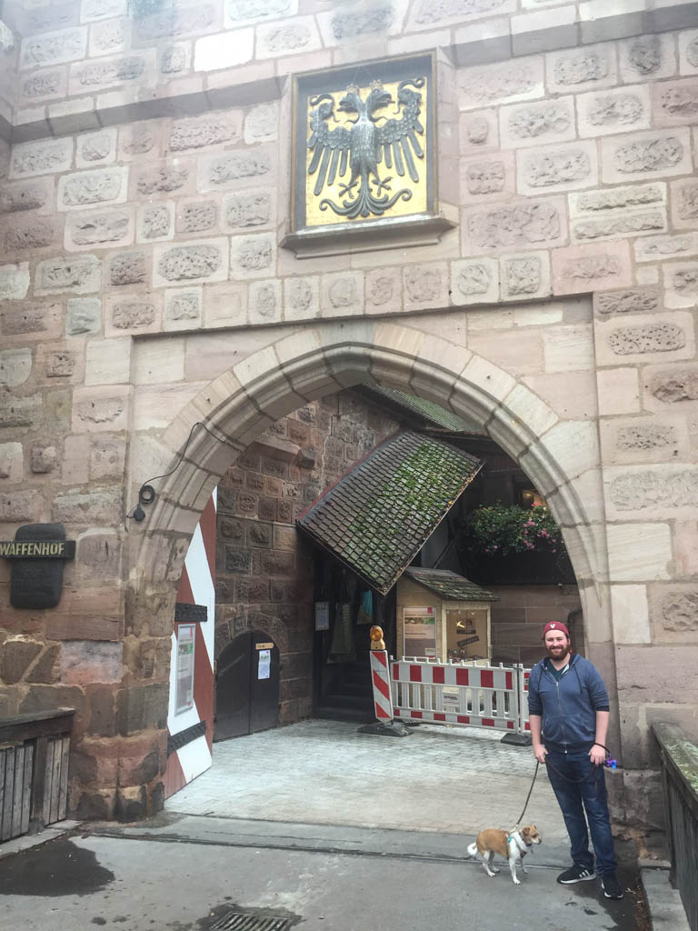 Colin and Ellie posing in front of the entrance to a cute fairytale area of Nuremberg