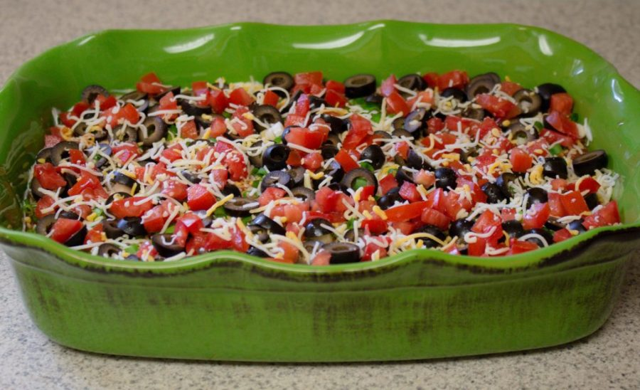 Mexican Seven Layer Dip is always a crowd pleaser and super easy to make!!