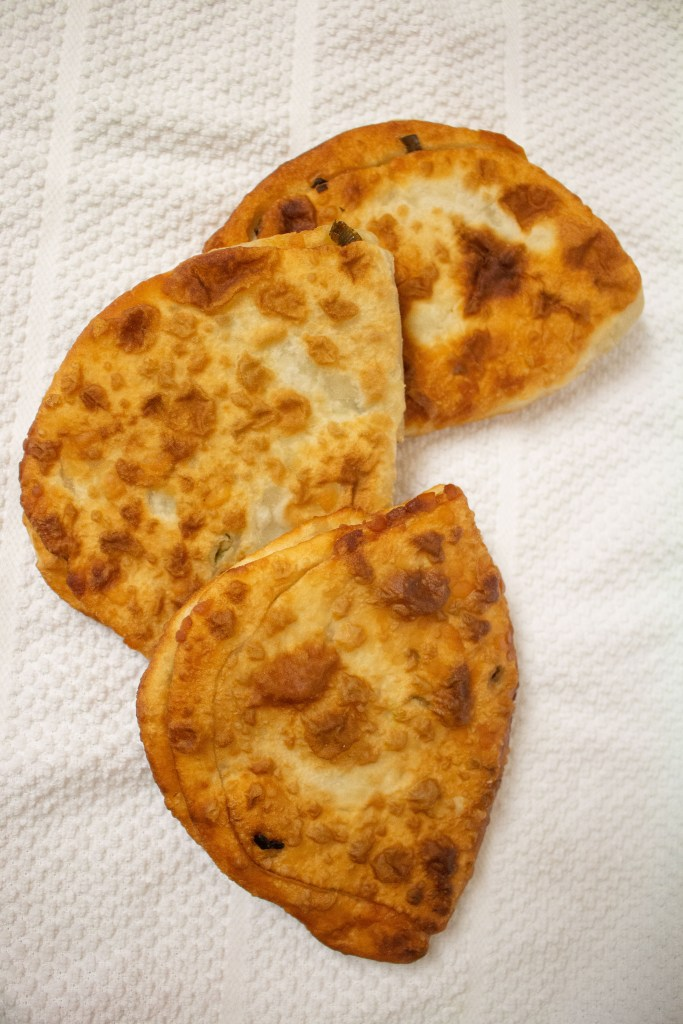 Scallion pancakes are the Chinese bread you didn't know you were missing! They're chewy, delicious counterpoints to your next Chinese dinner.