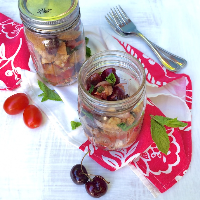 A portable summer salad perfect for the beach or a picnic featuring cherries, tomatoes, basil, mint, fresh mozzarella and bread - recipe for Cherry Caprese Panzanella at Teaspoonofspice.com