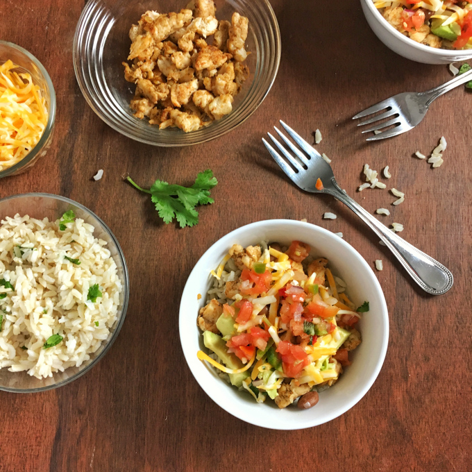 Build your own healthy Tex-Mex meal with deconstructed chicken burritos in bowls. Recipe at Teaspoonofspice.com