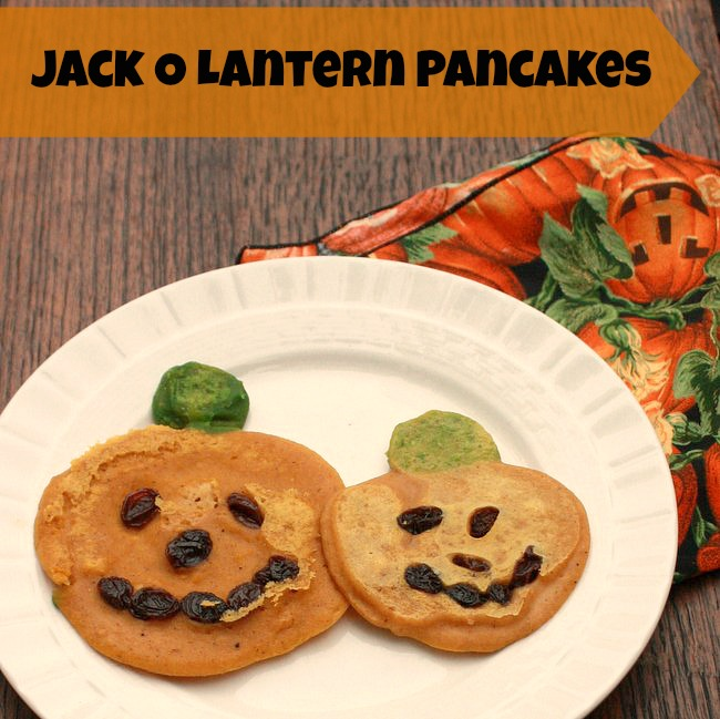 These kid friendly PUMPKIN PANCAKES are perfect for Halloween. Use natural green-pea-dye for the stems | @tspcurry - For more fall time recipes click: TeaspoonOfSpice.com
