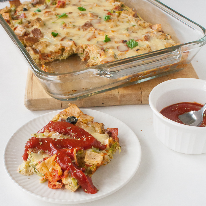 Easy and Cheesy Pizza Bread Pudding: A yummy way to use up leftover pizza. Dinner or brunch recipe that can be on the table in under an hour! | @TspCurry >> TeaspoonOfSpice.com