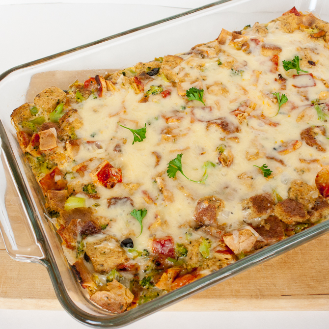 Easy and Cheesy Pizza Bread Pudding: A yummy way to use up leftover pizza. Dinner or brunch recipe that can be on the table in under an hour!   @TspCurry >> TeaspoonOfSpice.com