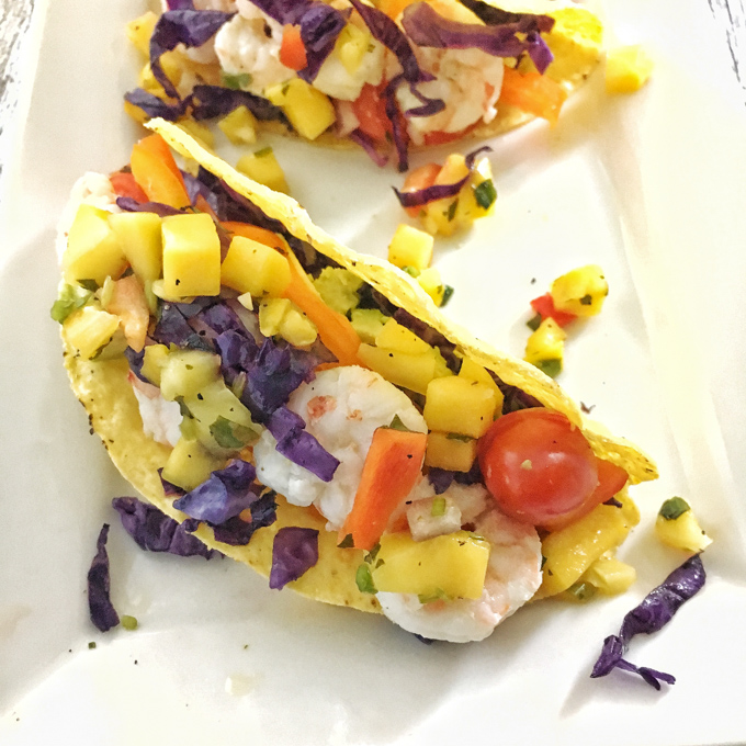 Get more fruit and vegetables into your lunch or dinner with these delicious shrimp tacos. Recipe at Teaspoonofspice.com