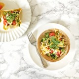 Make homemade taco bowls - with corn or flour tortillas - in your oven in 10 minutes! For this and more Healthy Kitchen Hacks, visit teaspoonofspice.com