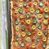 A crowd-pleasing appetizer made with hummus, puff pastry, zucchini, squash and carrots - recipe at Teaspoonofspice.com
