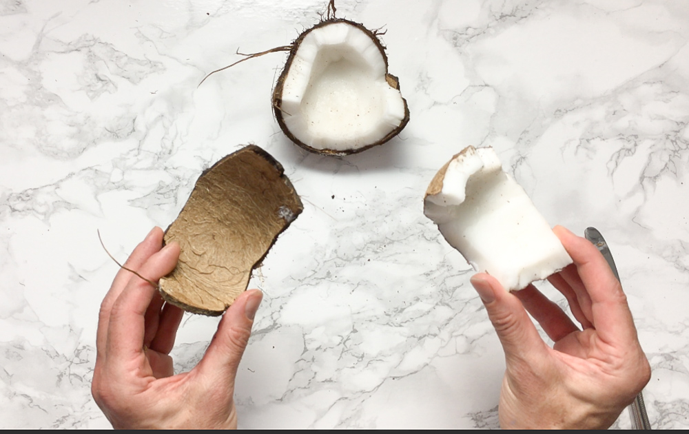 Here are the best ways to open young and mature coconuts - without any fancy tools! Healthy Kitchen Hacks at Teaspoonofspice.com