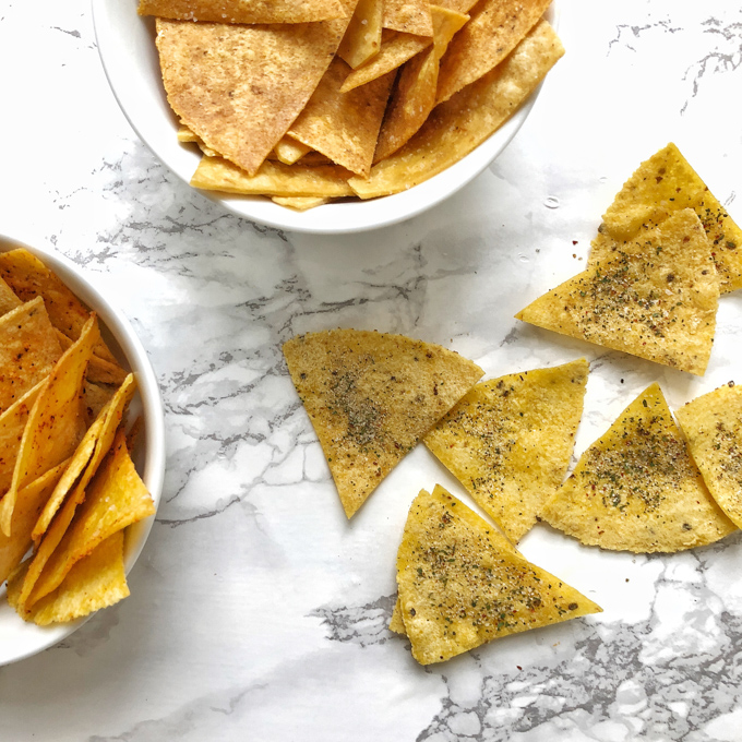 You can make tortilla snack chips at home in your oven or microwave. Check out our hacks for salted, ranch and nacho cheese flavors! Recipes at Teaspoonofspice.com