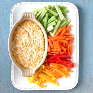 This buffalo chicken cheese dip is a crowd-pleaser and no one will miss the extra calories from the original. Recipe at Teaspoonofspice.com