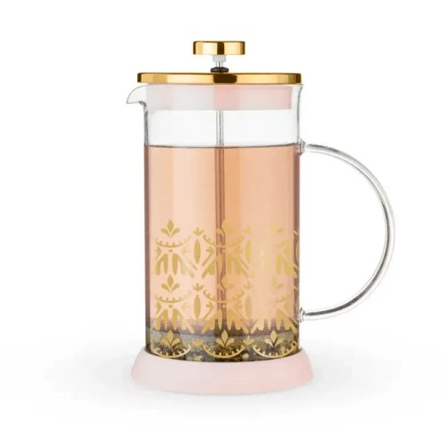 image of a glass tea press with pink and gold detailing