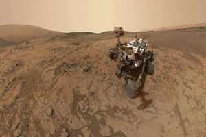 A NASA Mars photo taken by the Curiosity rover features an object that looks like a flying saucer. UFO enthusiasts think this could indicate presence of alien life on the Red Planet. Pictured is the Mars Curiosity rover.
