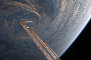 Astronaut aboard ISS shares pic of Storm at dusk that looks like solar arrays stirring the clouds
