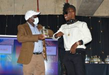 Konza Technopolis Development Authority (KoTDA) CEO Eng. John Tanui (left) with Flaqo Raz who won the Disruptor of the Year Award during the Africa Digital Influencers Awards (ADIA) 2020.The ceremony was held at Konza Technopolis