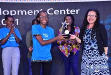 Bethany Jepchumba, a student from the Jomo Kenyatta University of Agriculture and Technology receiving the Award from Ruth Ferland Microsoft Africa Development Center.