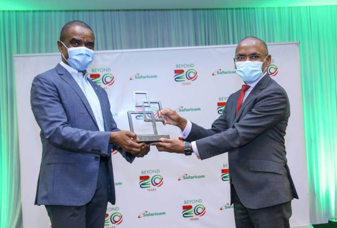 """Safaricom PLC has today been presented with the """"Outstanding Contribution to the Mobile Industry Award"""" by the GSM Association (GSMA)."""