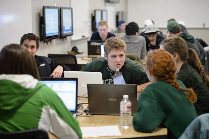 Students work togehter and collaborate in an MSU Room for Engaged and Active Learning