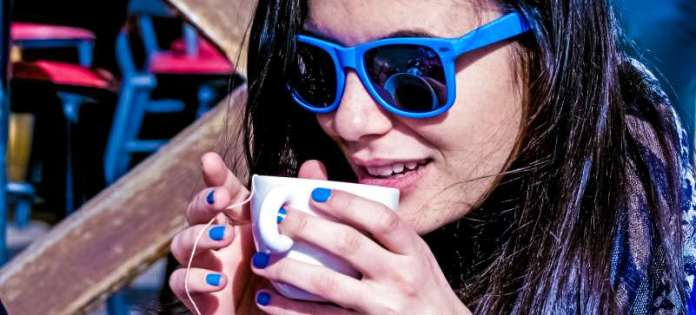 Personal Rituals Drinking Tea Time Woman Shades Glasses Matching Finger Nail Paint Enjoying Relaxing Break Work Office Focused