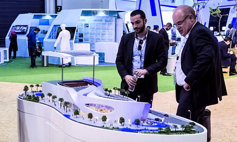 Future Cities Show 2017 Men Standing Around City Model Fair Exhibition Crop