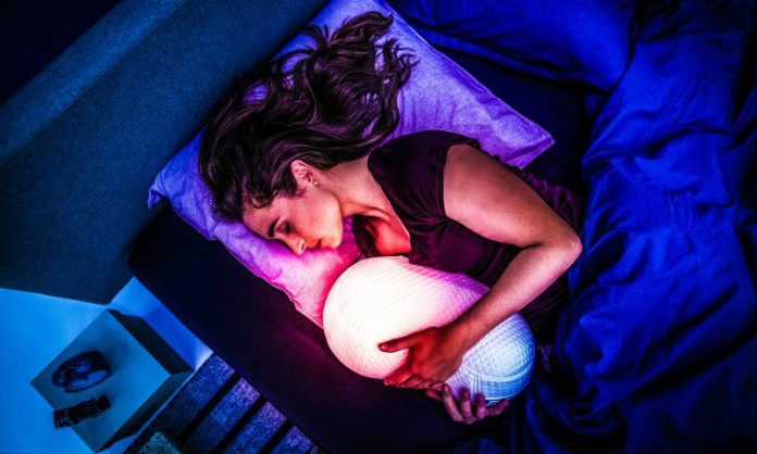 somnox sleep robot pillow woman lying in bed new product tu delft students