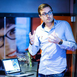Data Scientist Explaining Results Event Speech Presentation Man Stage Glasses Laptop Screen
