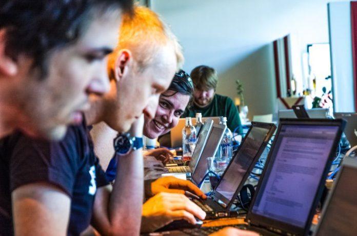 Hackathon Coding Programmer Team Woman Smiling Laptops Office Business Development Serverless Architecture Innovation Tech Enterprise Engineering IT