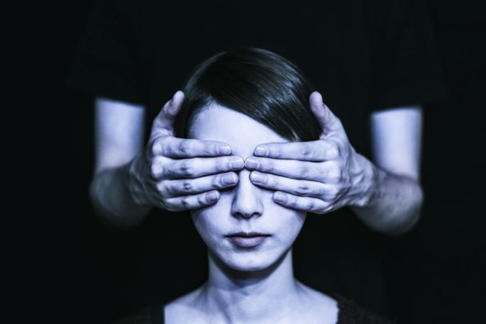 Blind Woman Covering Eyes Black Background