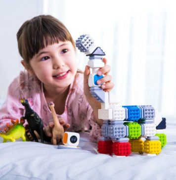 Cubroid Codingblock STEAM Coding Blocks Educational Learning Toy Making Building Understanding Girl Playing With Gadget On Bed