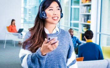 bluetooth-headset-logitech-zone-wireless-woman-smiling-happy-worker-talking-modern-office-space-technology-crop