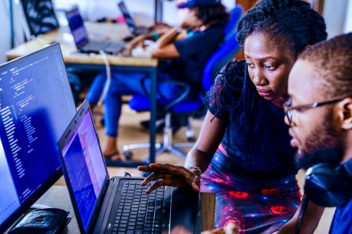 Woman Man Working Office Desk Laptop Screen Coding Programming PLC Solution