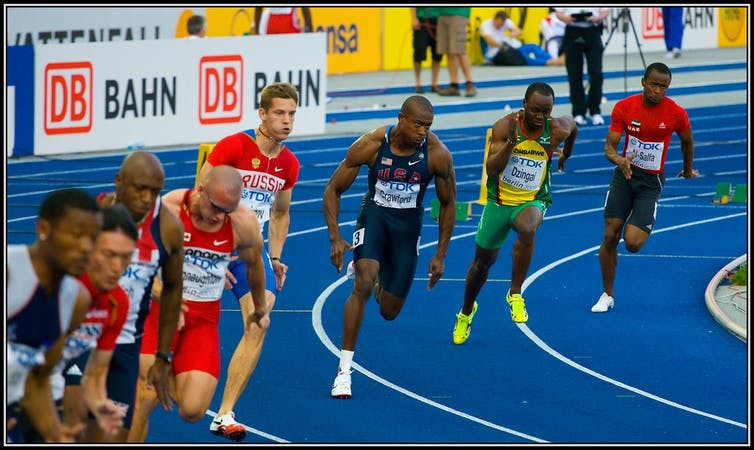 Runners in a staggered spacing coming around a turn.