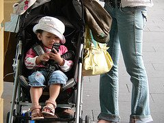 Toddler with mobile phone