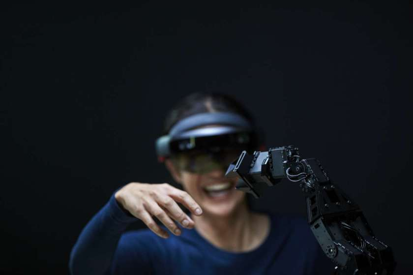 Ericsson: woman-using-ar-with-robotic-arm-brandmanual-powerpoint