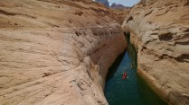 Clint Spahn and Brendyce Budd kayak through a Face canyon in Lake Powell.