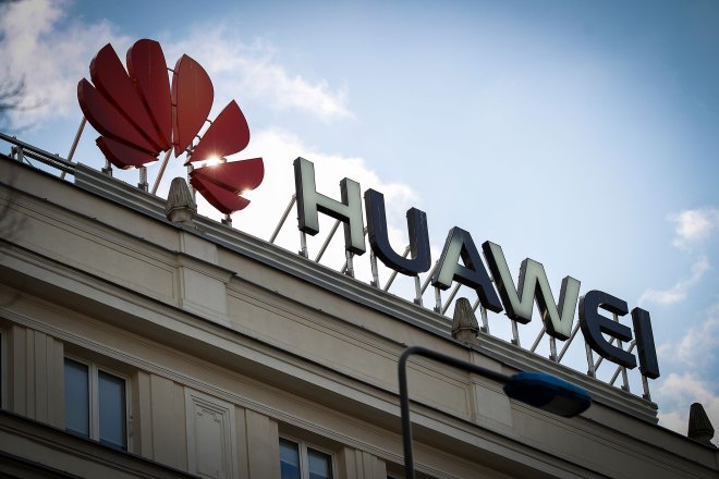 The Huawei logo is seen in the center of Warsaw, Poland