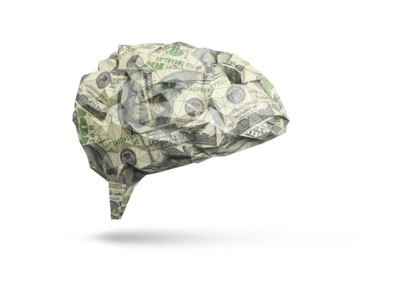 abstract human brain made out of dollar bills isolated on white background