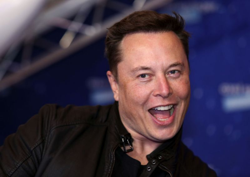 Elon Musk, founder of SpaceX and chief executive officer of Tesla Inc., arrives at the Axel Springer Award ceremony in Berlin, Germany, on Tuesday, Dec. 1, 2020. Tesla Inc.will be added to the S&P 500 Index in one shot on Dec. 21, a move that will ripple through the entire market as money managers adjust their portfolios to make room for shares of the $538 billion company. Photographer: Liesa Johannssen-Koppitz/Bloomberg via Getty Images