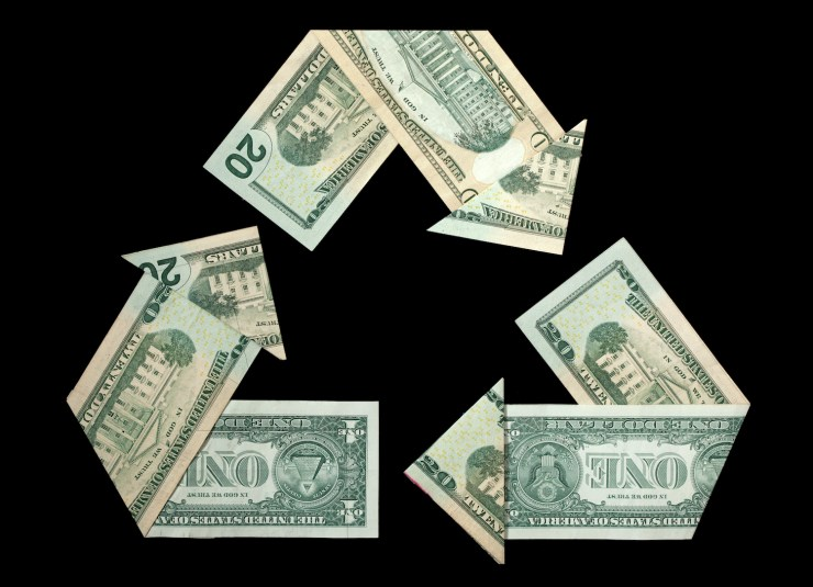 the recycle logo recreated in folded US currency no visible serial numbers/faces etc.