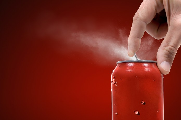 Someone pops tab on soda can, leaves mist/spray