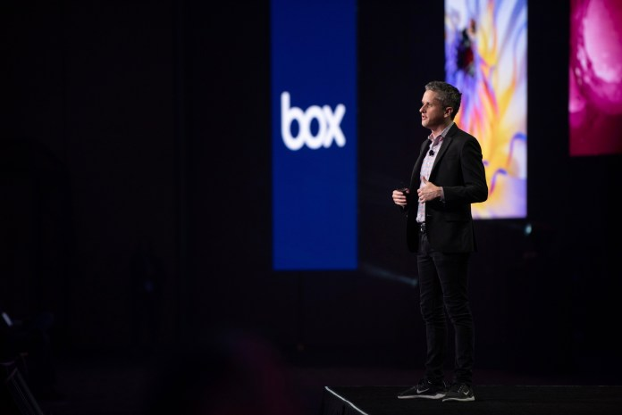 Box CEO Aaron Levy on stage in front of the Box logo.
