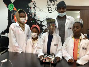 Cross-section of kids between the age of 5 to 15 showcasing their projects on Robotics