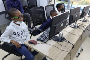 Cross-section of kids undergoing training on coding
