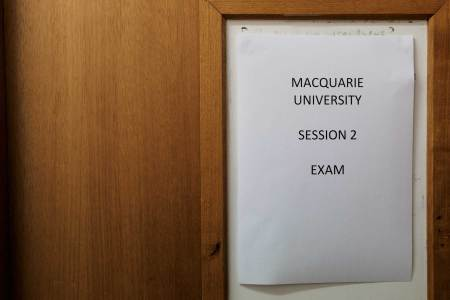 Door with 'Macquarie University Exam session 2' sign on the front