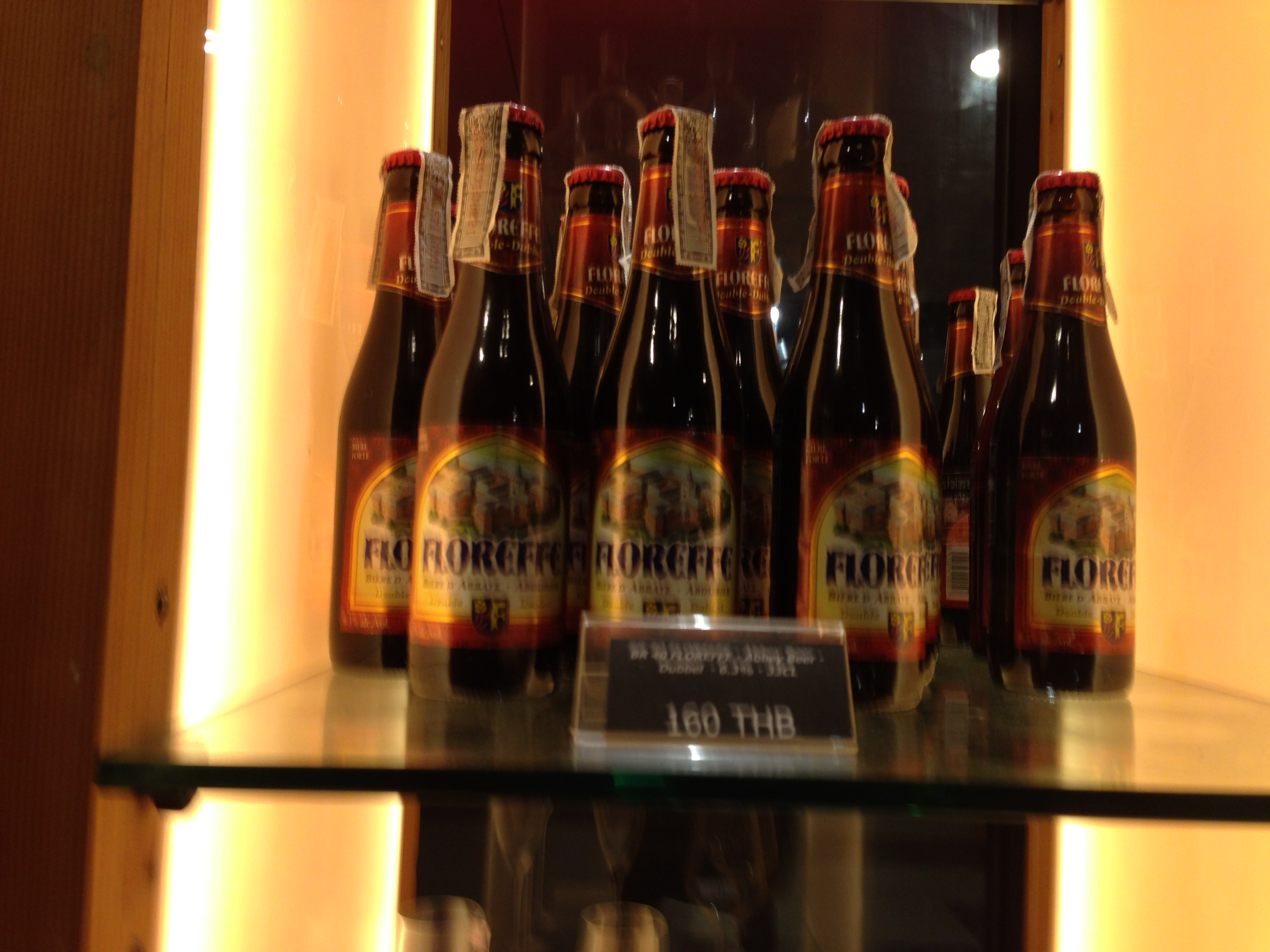 Bottles of Floreffe, a Belgian beer, displayed on a glass shelf. The price (160 Baht) is displayed.