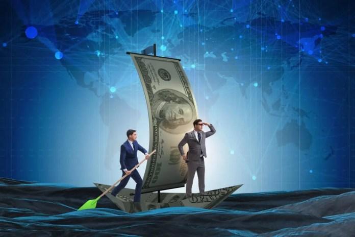 Business partnership with businessmen sailing on dollar boat. Elnur / Shutterstock.com