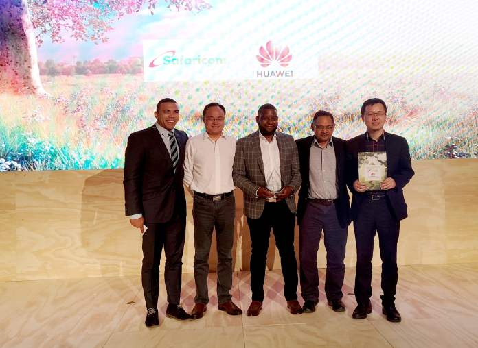"Safaricom and Huawei Executves at AfricaCom 2019, winners of ""Most Innovative Service"" Award."