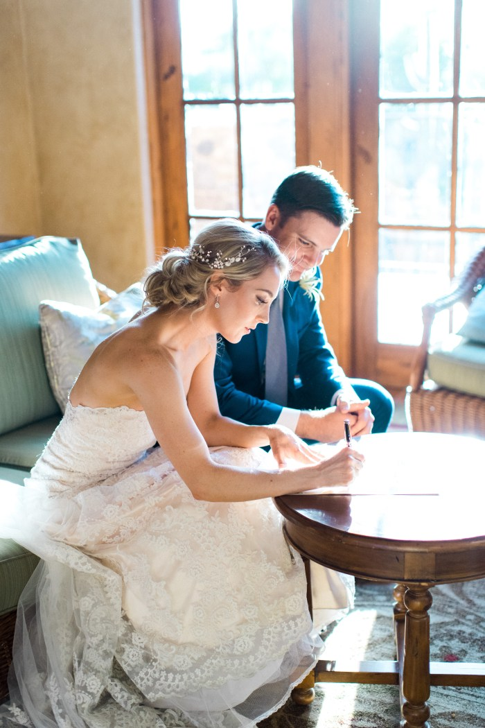 Me and my husband signing our marriage license