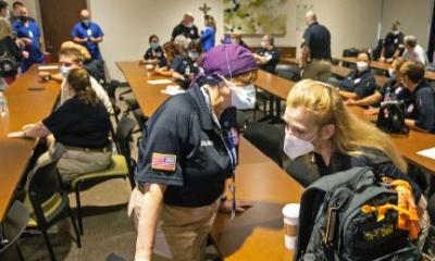 Hindy Bogner Orenstein, a nurse from Maryland talks to Bren Ingle, a nurse from Chattanooga, Tennessee, as nearly three dozen health workers from across the country arrive to meet staff at Our Lady of the Lake Regional Medical Center in Baton Rouge in August. to fill.  2, 2021.
