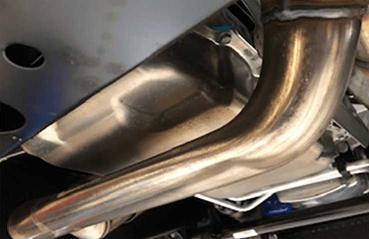 exhaust pipe shaped to avoid low