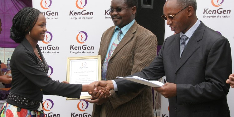 Mary Nyambura (left) shakes hands with KenGen Ag.Managing Director/CEO Simon Nguri (right) as she receives her University Scholarship from senior official, Ministry of Energy Mr.John Omenge. Mary Nyambura scored an A with 83 points in lasts year's KCSE.